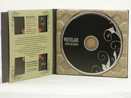 Recycled cd packaging with 100% recycled paper tray cork hub die cut windows in pocket