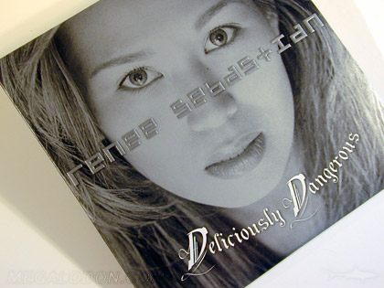Embossed jacket with metallic flood cd packaging