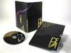 photo of slipcase, disc, traypak, special printing effects, gold foil